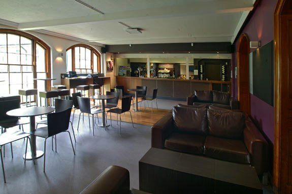 BiCon 2015 bisexual convention venue - the bar - with tables and chairs, sofas and large windows