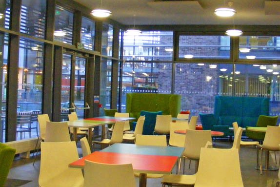 BiCon 2015 - coffee bar on first floor, daytime space - colourful tables, high glass windows and sofas